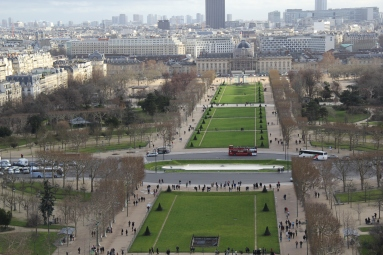 "Parc du Champs de-Mars, or the long stretch of park just south of the Eiffel Tower. The ""sky scraper"" at the end is Tour Montparnasse, Paris' tallest building."